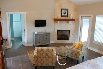 Seating area with gas fireplace and flat screen TV