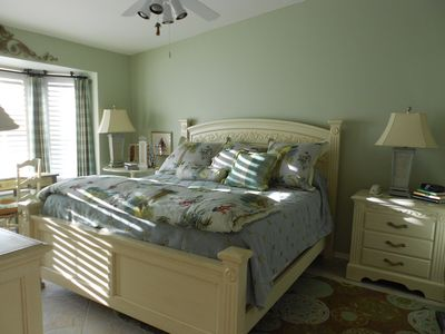 Beautiful master bedroom with king size bed, 2walk in closets, and attached bath