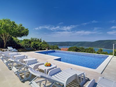 Photo for This 4-bedroom villa for up to 11 guests is located in Pula and has a private swimming pool, air-con