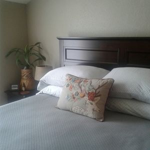 Queen size bed with choice of pillows and cozy linens