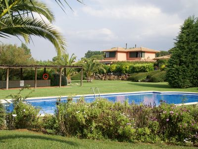 Photo for Semi-detached house on golf resort with large shared swimmingpool and big garden