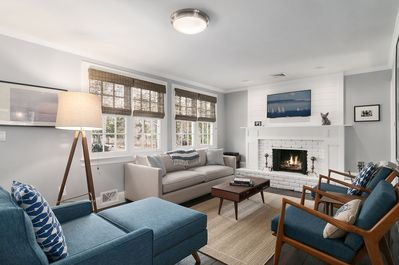 Bright living room with new furniture, firplace and 4K smart tv.