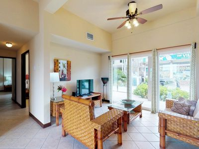 Photo for Ground-level condo w/shared pool surrounded by lagoon, walk to the beach!