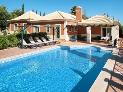 Photo for This 3-bedroom villa for up to 6 guests is located in Loule and has a private swimming pool, air-con
