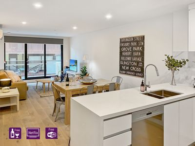 Warm open plan living and dining space with access to balcony.
