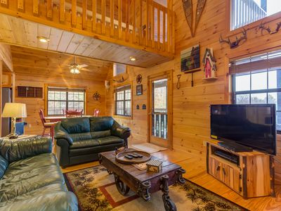 Photo for Dog-friendly cabin w/ private hot tub, mountain views, two fireplaces, Ping Pong