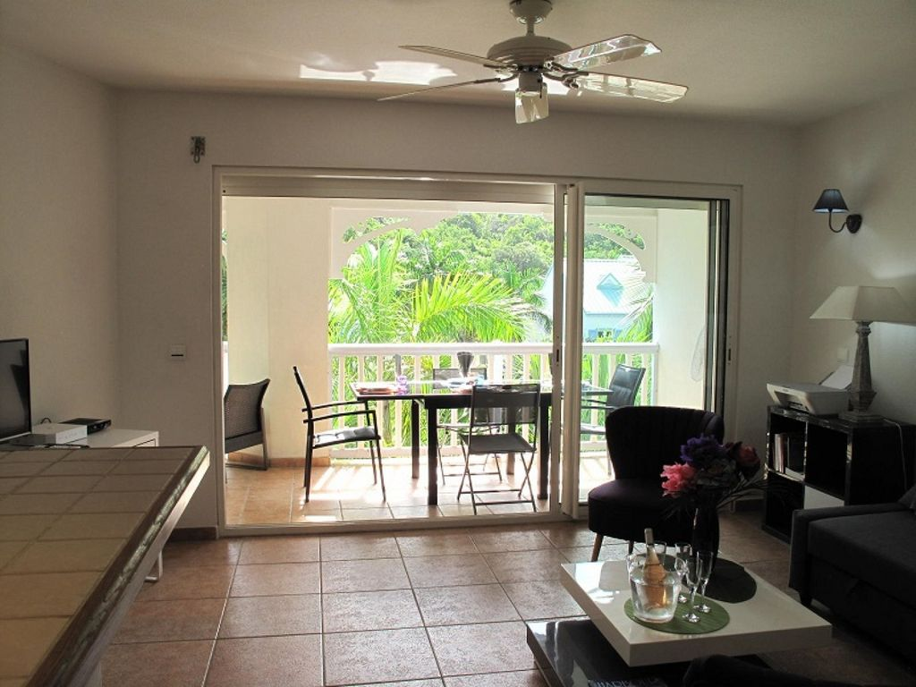 PORT CARAIBES 74...  Cosy 2nd floor condo in quiet, tropical area with gorgeous beach!!
