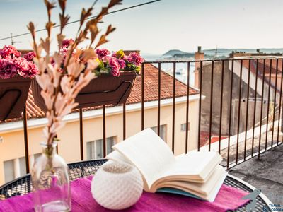 Photo for Breathtaking balcony view of the historic city center and the Adriatic sea