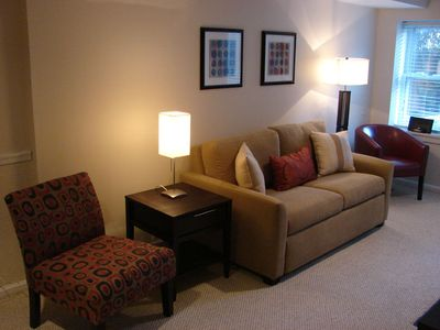 Livingroom - Seating for 4 guests faces fireplace and wall mounted HDTV. Sofa folds out to a double bed.