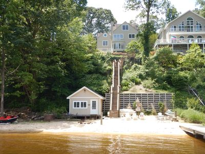 House, boat shed and private beach with natural sand and sandy bottom in river.