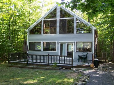Well kept Chalet on Frye Island with loft. Good Location. ask about Boat Slip.