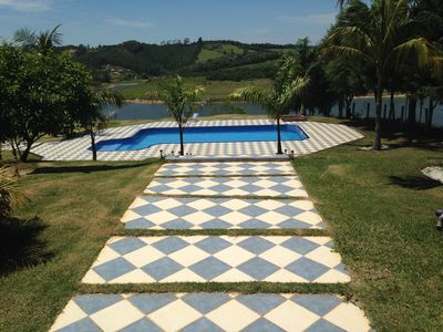 Photo for Wonderful site in front of the dam, swimming pool, barbecue.
