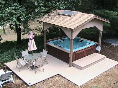 8 person hot tub with it's own deck.