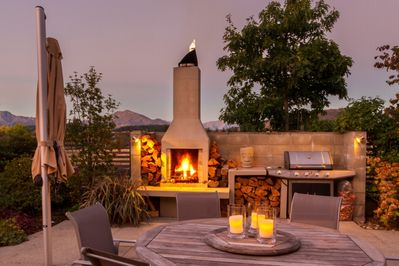 Outdoor dining andamp; fireplace
