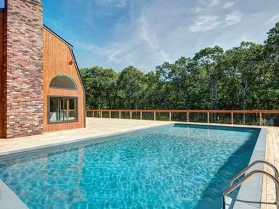 Photo for Secluded home w/private heated pool, expansive deck and views of the woods.