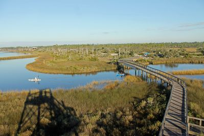 Enjoy fishing, kayaking and paddle-boarding along Bayou Grande