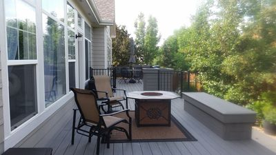 Back deck with grill, fire pit, awning, and plenty of seating