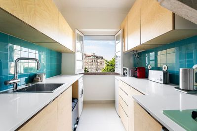 Fully equipped kitchen with views of the neighborhood.