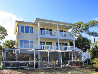 """Photo for FREE BEACH GEAR! Bayfront, Pets OK, Pool, Fishing Pier, Hot Tub, Fireplace, 4BR/3BA """"Constantine"""""""