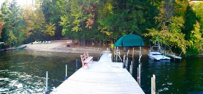 Boat docks have protective whips.  October foliage view.