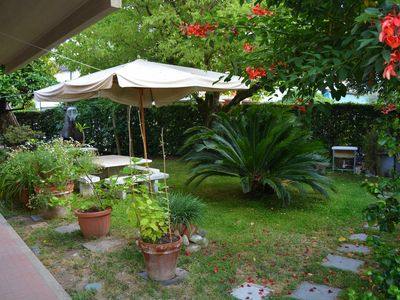 Photo for Apartment with beautiful garden and close to the beach of Forte dei Marmi.