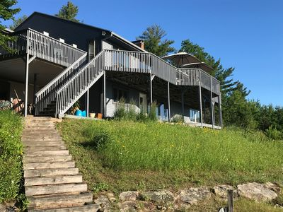 Photo for House on a hill w/180 degree view of Lake Winnipesaukee, mountains and islands.
