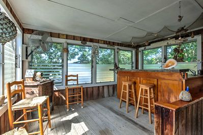 The enclosed porch is the perfect spot for gathering with your group of 8.