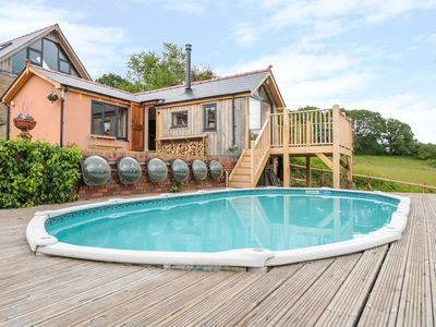 Photo for THE HIDEOUT, pet friendly, with pool in Llangrove, Ref 1013778