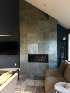 Our slate fireplace is the focal point of the living room and very cozy indeed!