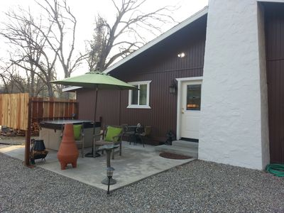 Riverside's private patio, hot tub and chimnea.