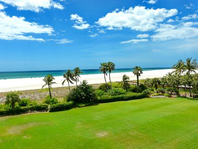 Photo for Stylish beachfront condo w/ heated pool near Island's favorite restaurants