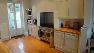 The kitchen with 6 burner hob & double oven. French doors to rear courtyard.