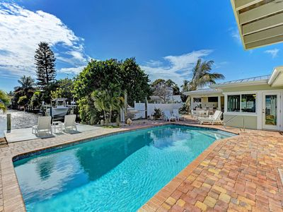 Photo for Living the Dream: Heated Pool, Canalfront, Dock, Across the street from the Bay!