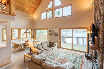 Welcome! Open main level living and dining open on to a huge lakeside deck!