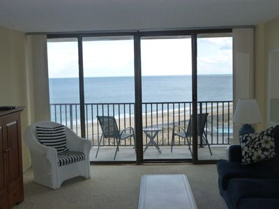 Living room view showing pool in right hand corner