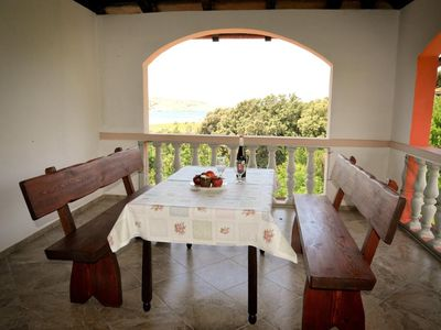 Photo for Two bedroom apartment with terrace and sea view Lopar, Rab (A-18005-c)