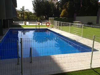 lovely communal pool with sunbathing area