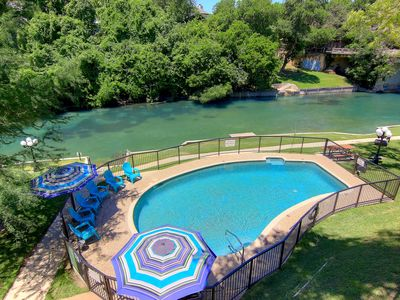 Photo for Inverness 216, FABULOUS  2/1 condo right on the Comal River!