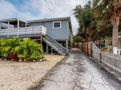 Photo for NEW LISTING! Renovated duplex retreat w/screened porch - beach across the street