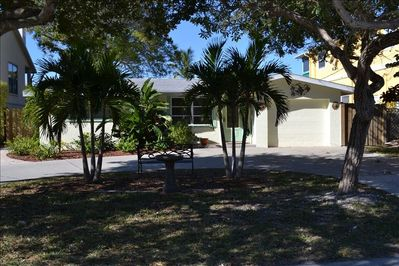 Front of House, Circular Drive Way, Fenced Yard with Gates on both sides.