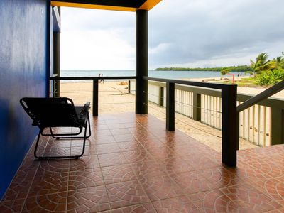 Photo for Gorgeous oceanfront home w/private beach right in Placencia Village