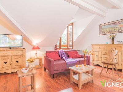 Photo for Surface area : about 48 m². 1st floor. Orientation : North, South. Living room with bed-settee