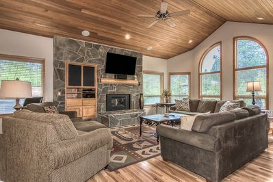 Inviting open spaced living room, gas fireplace, HDTV, windows with views
