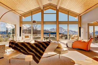 Double height living room with breathtaking views of Swiss Alps