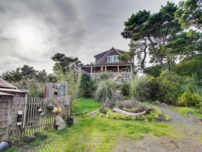 Photo for Dog-friendly home with guest cottage, private hot tub, and close beach access!