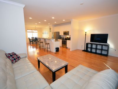 Photo for Classy, stylish luxury 4 bedroom townhouse with outdoor pool, free WiFi, a garage, and beautiful bay view located midtown and a mere two blocks from the beach!