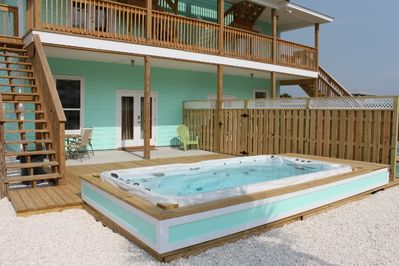 LARGE PRIVATE BACK DECK WITH PLENTY OF ROOM FOR LAYING OUT IN THE SUN