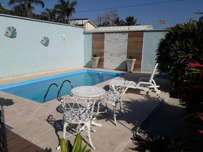 Photo for Beautiful house with pool, gourmet space, 4 suites, 5 parking spaces.