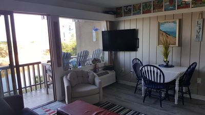 Plenty of indoor and outdoor seating. Extra tall Adirondack chairs on the deck