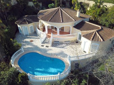 Photo for Dream villa with a large Mediterranean garden, pool and sea views